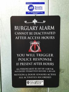 Storage facility burglary alarm sign