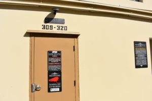 Storage Unit Hallway Alarm and Security Camera Warnings and Overhead Motion Sensor Lighting